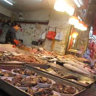 As a part of the Chinese-cooking class I took in Hong Kong, two classmates and I joined the instructor in shopping for ingredients at a Hong Kong wet market.